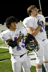 Mason High School's David Mora places his hand over his heart for the national anthem before the regional final against Goldthwaite at Mustang Stadium in Marble Falls on Dec. 3, 2010.