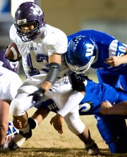 Mason's David Mora fights through tackle attempts by Winters players during their game in 2010.