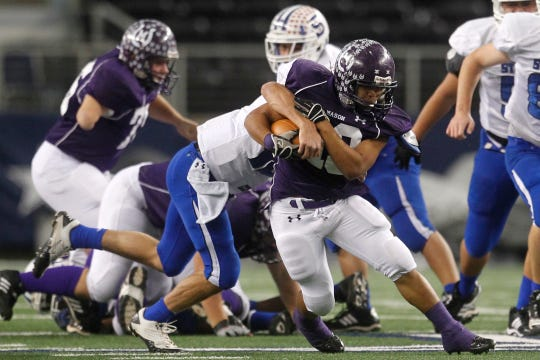 Mason High School's David Mora tries to avoid a tackle by a Stamford player during the first half of the Class 1A Division I State Championship on Dec. 15, 2011.
