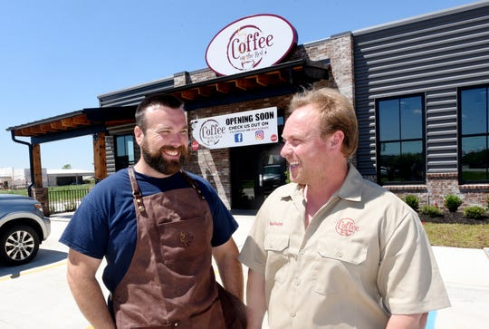 Coffee on the Red owners (and brothers) Andrew Lewis and Nelson Lewis will open for drive-thru only services on May 4.