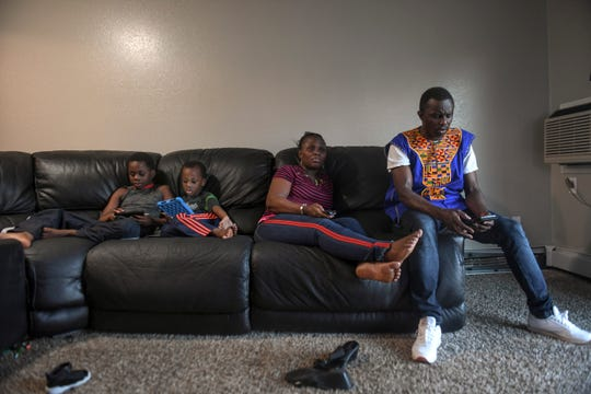 John Deranamie spends time with family on Wednesday, April 29, 2020 at his home in Sioux Falls, S.D. Deranamie, a Smithfield Foods employee, tested positive for COVID-19 and has been spending time at home with family since the meatpacking plant shut down.