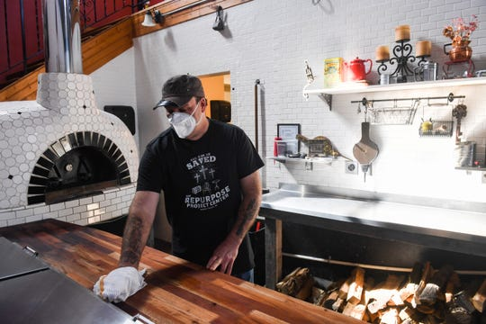 Owner Travis Graham prepares to reopen Books N Brewz on Thursday, April 30, in Sioux Falls.