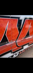 Chad Kuhnert's grandchildren's names,  Kayzleigh and Jace, are part of the paint scheme on the side of his No. 44 USRA Hobby Stock race car.