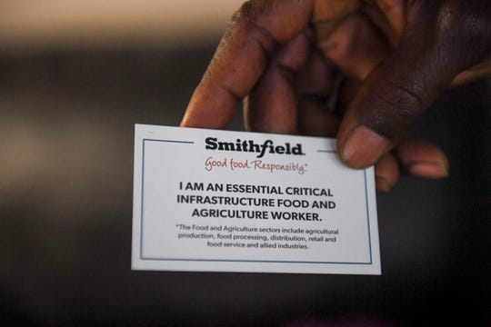 John Deranamie holds a card given to him and his wife, Marie Cole, from Smithfield on Wednesday, April 29, 2020 at his home in Sioux Falls, S.D. Smithfield Foods workers are deemed essential since the company is the world's largest pork producer.