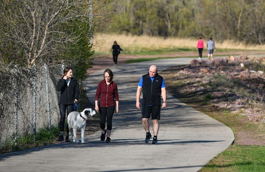 People take advantage of the nice weather on Wednesday, April 29, on the bike and walking trails around Sioux Falls.