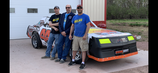 Chad Kuhnert (Right) along with car owners Ryan Mulder (left) and Rick Mulder.