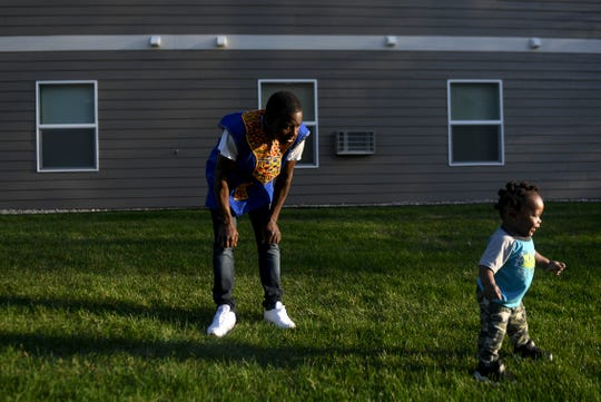 John Deranamie spends time with his youngest son, Nehemiah Deranamie, 1, on Wednesday, April 29, 2020 at his home in Sioux Falls, S.D. Deranamie, a Smithfield Foods employee, tested positive for COVID-19 and has been spending time at home with family since the meatpacking plant shut down.