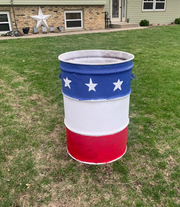 A patriotic garbage can painted by Kellen Olson, Braley Olson and Mackenzie Tekrony is now located next to First National Bank baseball field at Aspen Park.