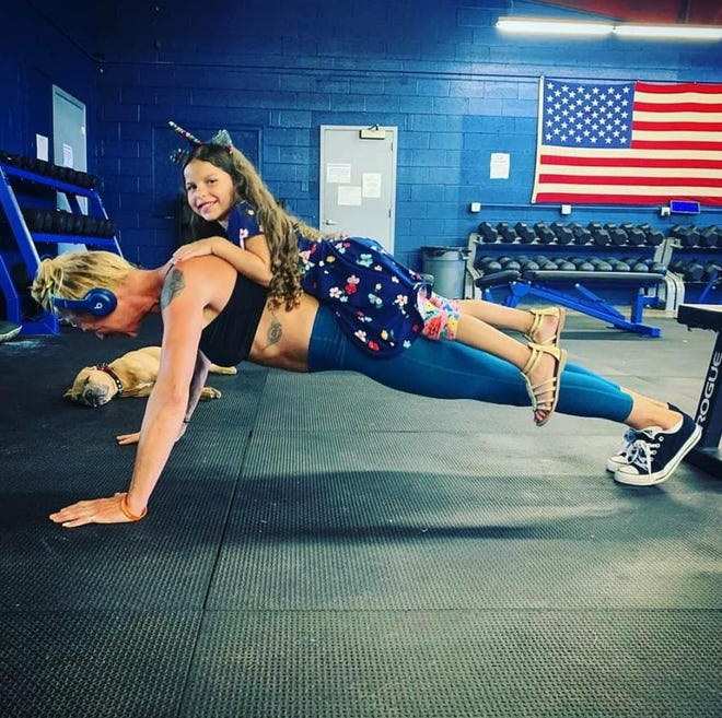 Queen City Strength in Staunton is facing some tough decisions if they can't reopen soon due to COVID-19. The gym has been loaning out equipment and posting workouts online, but owner Page Hearn (pictured here in the push-up position) said they need to get their members back in the physical space.