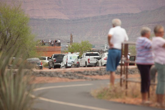 Crowds around St. George gather to watch four members of the Hill Air Force Base 388th Fighter Wing fly over Thursday, April 30, 2020.