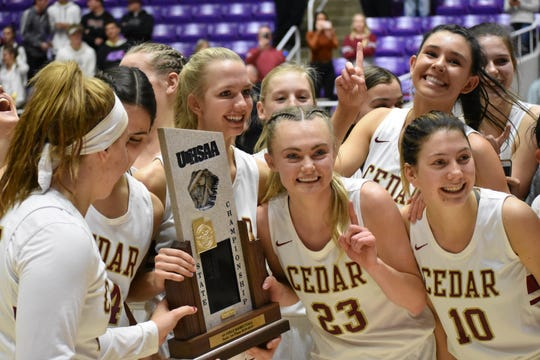 Cedar's Mayci Torgerson made the difficult decision of leaving basketball behind to run track in college.