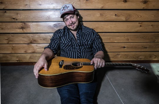Adam Greuel, singer and guitarist for the bluegrass band Horseshoes & Hand Grenades, has released a solo album