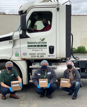 Innovation Foods workers on Thursday hold some cases of Formula71 hand sanitizer the company created and is giving to hospitals in South Jersey, Philadelphia, and New York City. Holding the cases (left to right) are Levy Hobbs, Rich Facemyer, and Maurizio Genta. Tom Bonham is the truck driver. CREDIT: Innovation Foods.