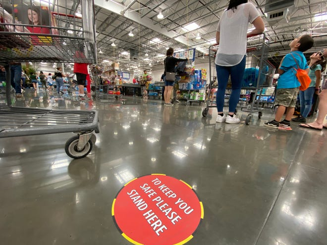 On Saturday, Costco required shoppers to wear face masks when entering the warehouse.