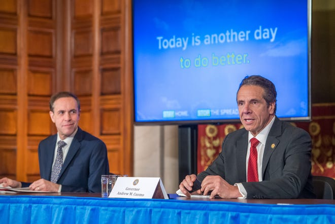 Gov. Andrew Cuomo delivers his daily press briefing on coronavirus alongside Health Commissioner Howard Zucker on April 30, 2020, at the state Capitol in Albany.