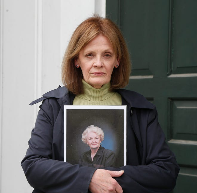 Kathleen Cole holds a portrait of her mother Dolores McGoldrick at Hurley Reformed Church on April 29, 2020. McGoldrick succumbed to COVID-19  at Northern Dutchess Hospital on April 17.