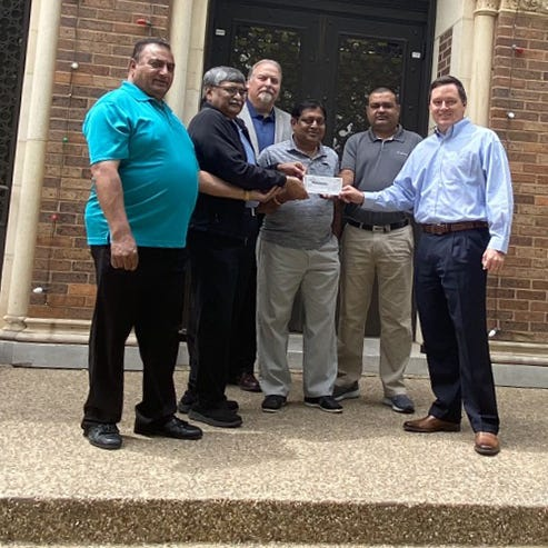 From left, Uttam Tilala, Bhulabhai Desai, Praful Patel, and Hermansu Patel, present a check to Dr. Michael Mills, MSU Texas, to help MSU international students during the COVID-19 situation.