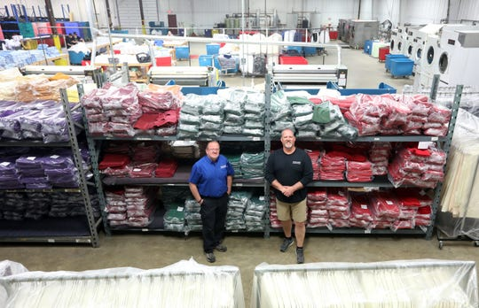 Bob Carpenter, left, and Tim Andrews own New Service Concepts in Zanesville. The company provides textile leasing and sales and promotional products.
