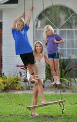 Brittany Anthony and her children Owen, 9, left,  and Quinn, 7, have been working and schooling from home during the coronavirus pandemic in Jacksonville Beach, Fla.