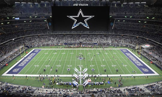 General overall view of AT&T Stadium with the Dallas Cowboys logo on the video board.