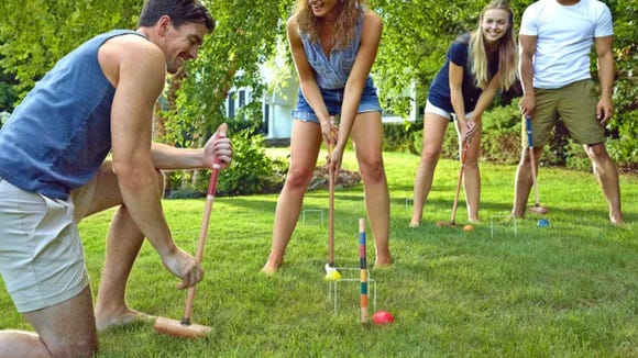 Have more fun in your backyard with this croquet set.