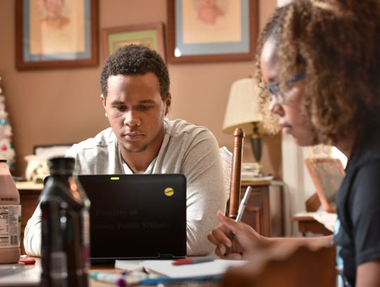 Ty Jackson, 18, studies with his sister Ellie, 15, at his home during the coronavirus pandemic on April 16 in Jacksonville, Florida.