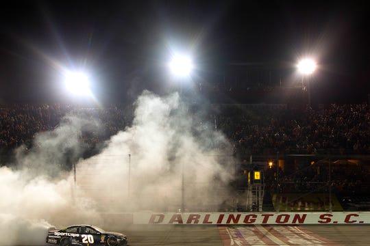 NASCAR Cup Series driver Erik Jones celebrates a September 2019 win at Darlington Raceway.