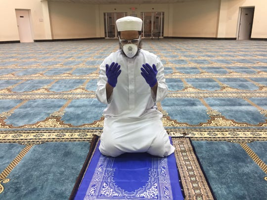 Azfar Uddin, imam and resident scholar at Islamic Foundation North in Libertyville, Illinois, prays alone on April 23, the first night of Ramadan.
