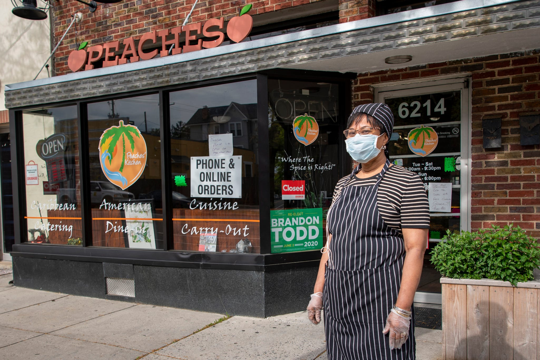 Peaches Watson stands outside Peaches Kitchen Restaurant & Catering Service in Washington, D.C. She said she is struggling to keep her business open amid the coronavirus shutdowns.