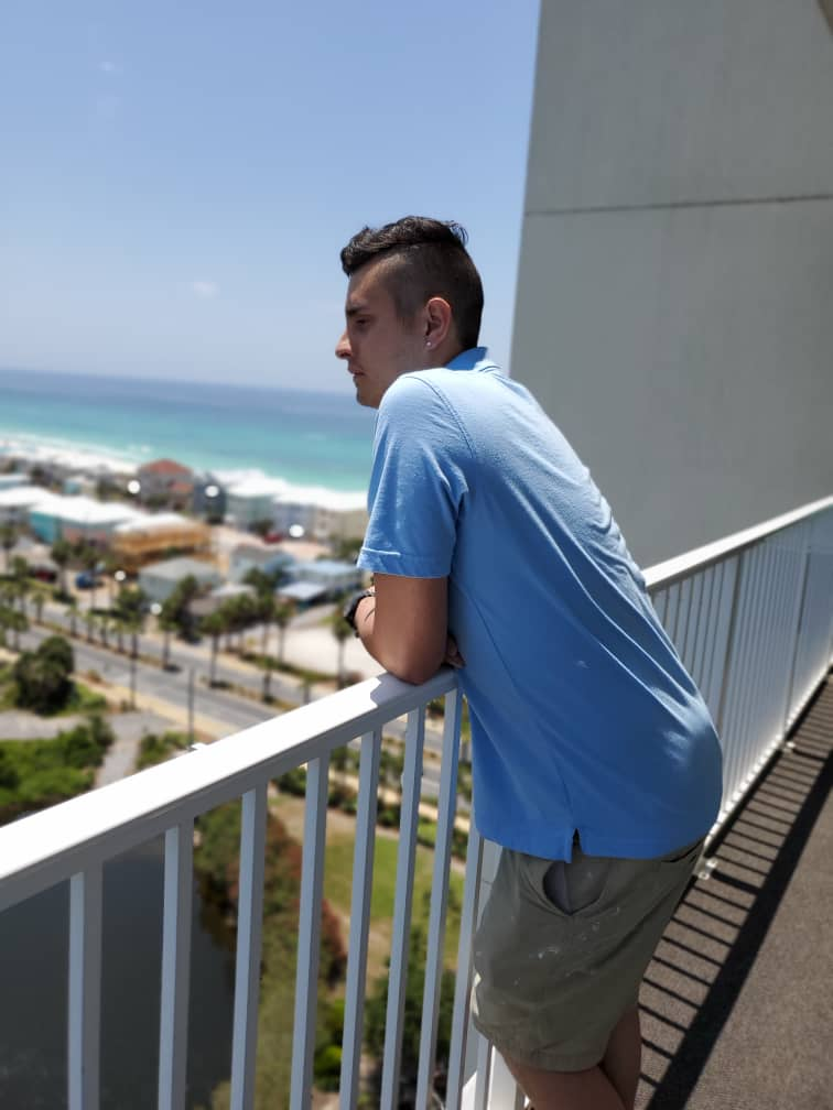 Emilio Rivamar stands on a balcony of a hotel he was painting in Panama City Beach, Florida, before he was laid off because of a downturn in bookings from the coronavirus pandemic.
