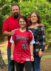 Kirsten Meeks (center) is one of many seniors whose senior season was lost to COVID-19. With parents Jimmy and Bonnie Meeks.