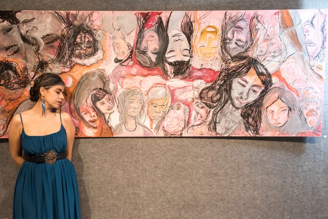 Martha Skinner, here beside an ongoing project from her #FacesOnTopOfFacesSeries, earned the first grant from the Madison County Arts Council's Artist Relief Fund.