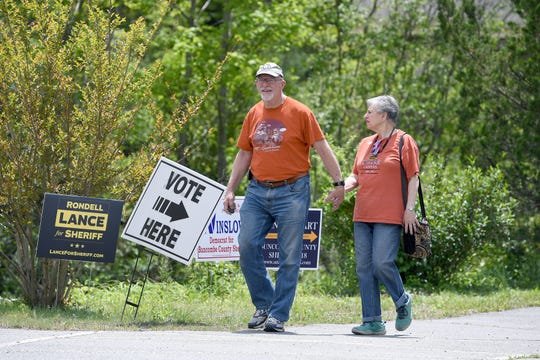 Dan and Gloria Pincu leave a Fairview election precinct after voting in the primary election in May 2018. Dan Pincu died April 27, 2020, from COVID-19, and Gloria remained in Mission Hospital fighting her own battle against the disease. The couple, married 54 years, were involved in a wide range of volunteer activities locally.