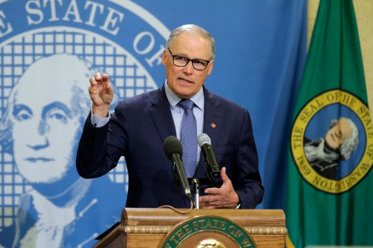 FILE - In this Monday, April 13, 2020, file photo, Washington Gov. Jay Inslee speaks during a news conference at the Capitol in Olympia, Wash. Inslee has repeatedly said he will rely on scientific models and input from state health officials to determine when stay-at-home orders can be relaxed, despite growing calls for them to be ended, including a protest that drew about 2,500 to the state Capitol. (AP Photo/Ted S. Warren, File)