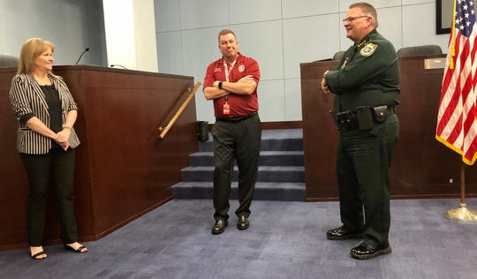 Brevard County Commission Vice Chair Rita Pritchett, Public Safety Director Matt Wallace  and Sheriff Wayne Ivey talk before a news conference Friday on local response to the coronavirus pandemic