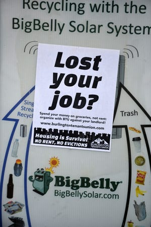 A Burlington Tenants Union flyer tacked on a recycling bin on College Street in Burlington seeks organize renters, seen on Friday, May 1, 2020.