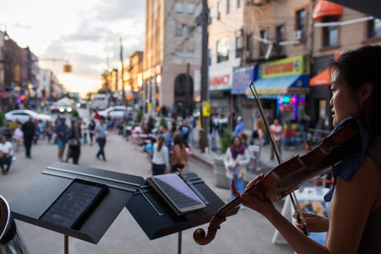 A violinist performs on a Yellow Barn Music Haul visit to New York City.