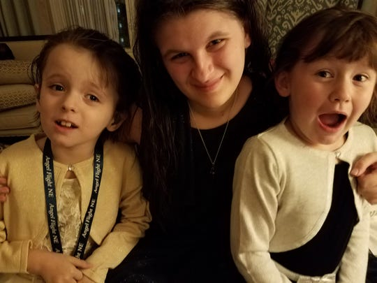 The Carroll girls: Addison, 9, Savannah, 17, and  Isabella, 7, of Essex struggle with losing support services for special needs and remote learning during stay at home order resulting from the COVID-19 pandemic. April 2020.