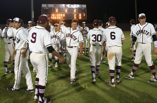 Flour Bluff players celebrate after snapping Moody's 22-year streak in the baseball playoffs with a 5-2 win in the regular season finale in 2015.