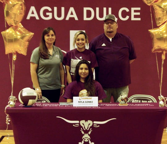 Agua Dulce libero Nyla Gomez signed to play volleyball at Oak Hills Christian College on April 30.