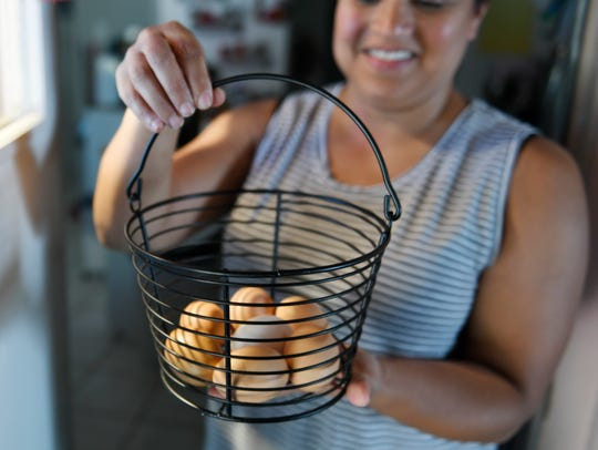Nicole Ruiz shows her chicken's eggs, Thursday, April 30, 2020. The family has six chickens.