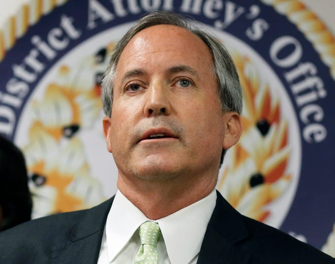 FILE - In this June 22, 2017, file photo, Texas Attorney General Ken Paxton speaks at a news conference in Dallas. Records reviewed by The Associated Press show that an exclusive group of Texans stood to benefit when Paxton, urged a small Colorado county to reverse a public health order during the coronavirus outbreak. Paxton this month told Gunnison County that banning Texans from their property in Colorado during the outbreak was unconstitutional.  (AP Photo/Tony Gutierrez, File)