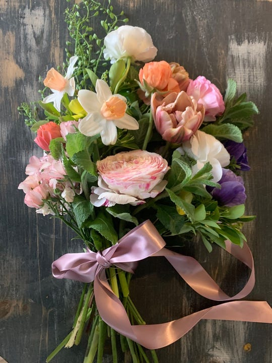Customers can buy a floral bouquet with their Mother's Day takeout meal at blueplate in Mullica Hill.