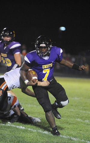 Uniotos Jamarcus Carroll runs the ball during the game last season against Amanda-Clearcreek. Carroll has committed to play college football at Otterbein University.
