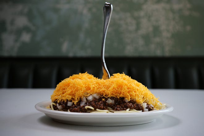 A Cincinnati chili 5-way with onions and beans, pictured, Friday, May 1, 2020, at OTR Chili on Elm Street in Cincinnati.