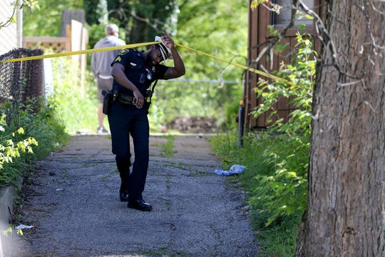 Cincinnati police district four officers investigate a shooting, Friday, May 1, 2020, near the intersection of Lincoln and Stanton avenues in Mount Auburn. The victim, a man in his early 20s, suffered a non-life threatening injury to his leg, police said.