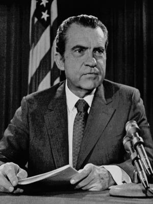 President Richard Nixon poses for pictures in his White House office, on Aug. 15, 1971, after a nationwide television speech which dealt with economic policies.