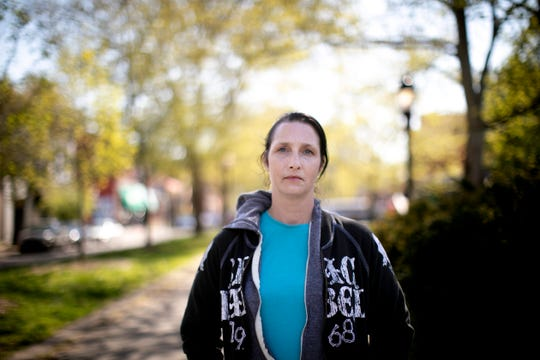 Jennifer Anderson, 40, has battled addiction for 20 years, going in and out of sobriety and treatment. 'With the corona thing, it's been hard. It's been scary,' she says. For her, limited access to meetings has been particularly hard. Here she sits in a park in Covington on April 22 before heading to a treatment center. 'I'm not trusting this area,' she said. 'I need to relearn behaviors.'