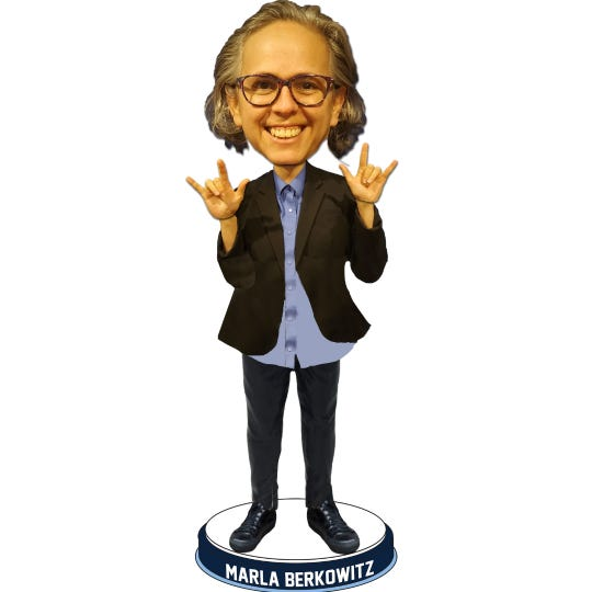The National Bobblehead Hall of Fame and Museum created a bobblehead of interpreter Marla Berkowitz.