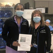 Members of the Overlook Radiology Department enjoy a donation of food and a note of thanks from the Roosevelt Intermediate School Student Government.